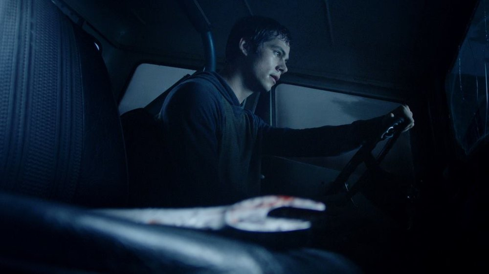 Stiles drives away from the scene of the killing, murder weapon in tow.