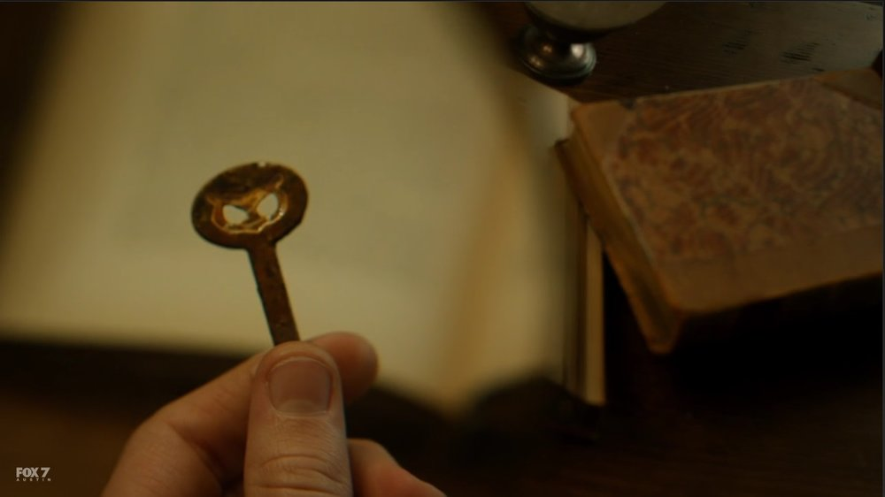The owl key from Ivy's stolen necklace.