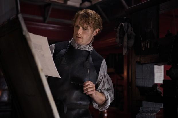 Jamie looking at papers printshop.jpg