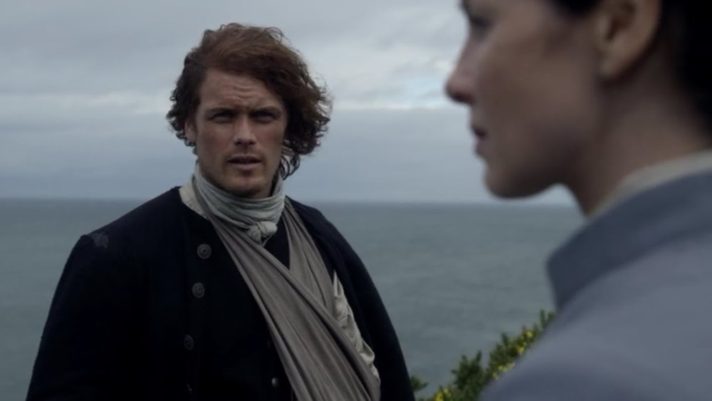 Jamie and Claire on cliff.jpg