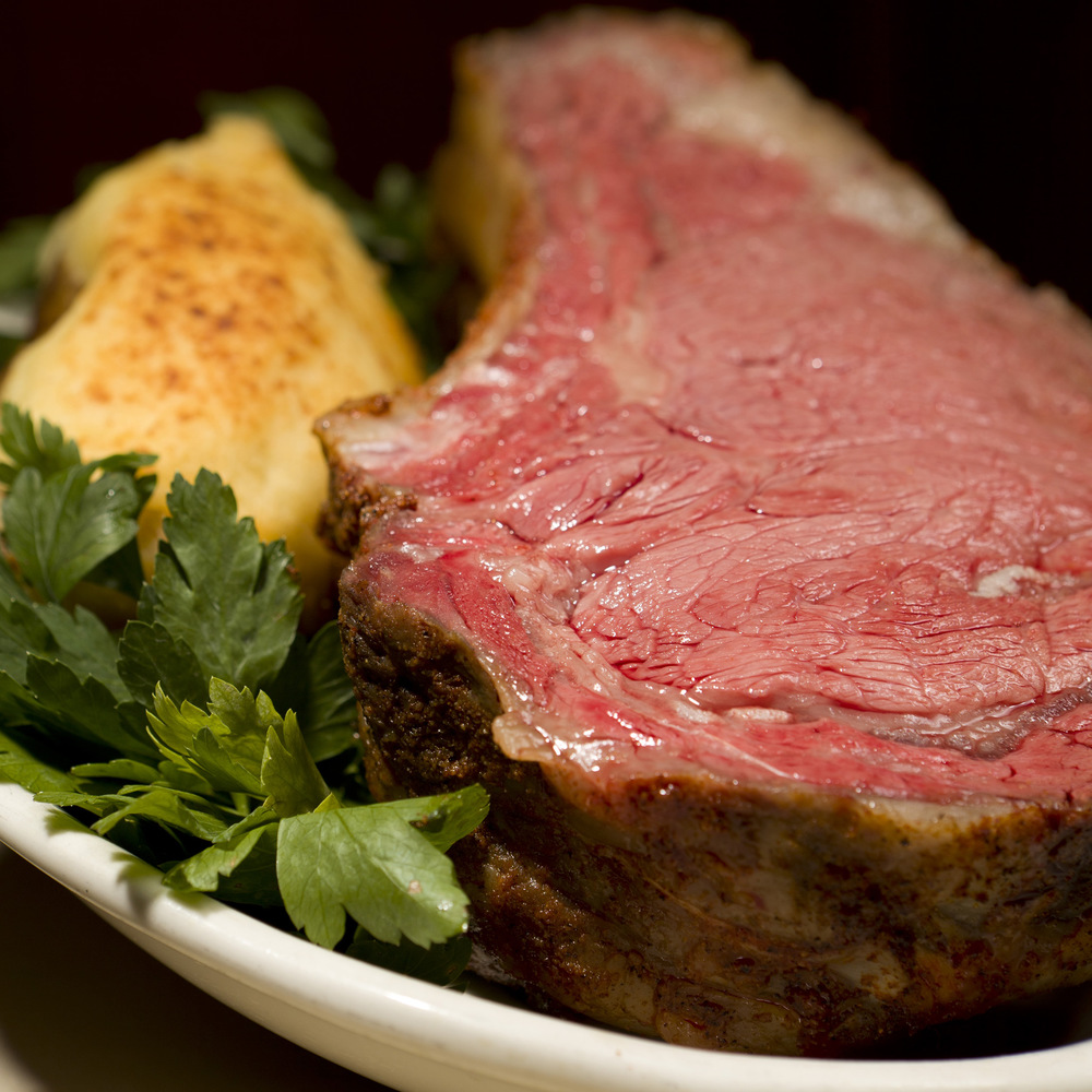 Photo is a Prime Rib of Beef King Cut. Special is a Prime Rib of Beef Queen Cut.