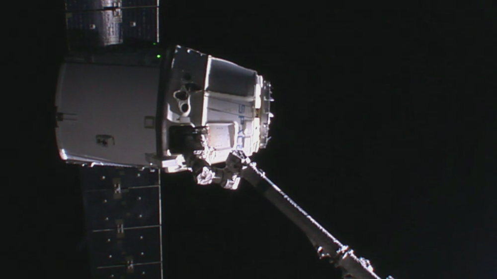 R2D2? No. SpaceX Dragon coming into berth with the help of the Canada arm