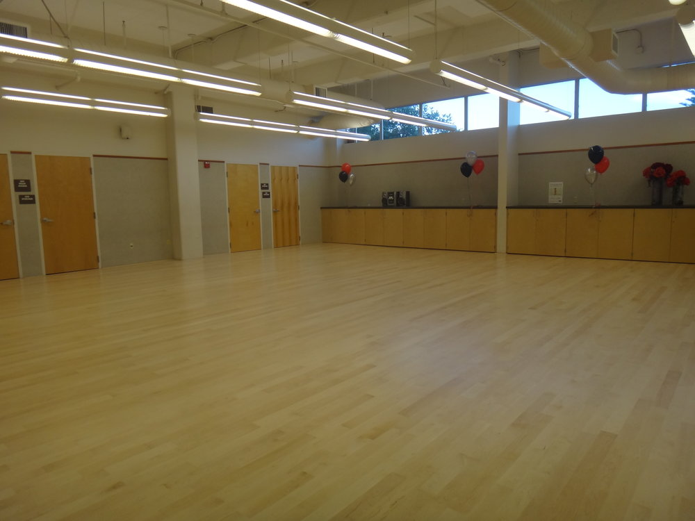 The beautiful hardwood floor is ideal for conducting dance classes and rehearsals in the space that was originally used to store props for civic pagentry.
