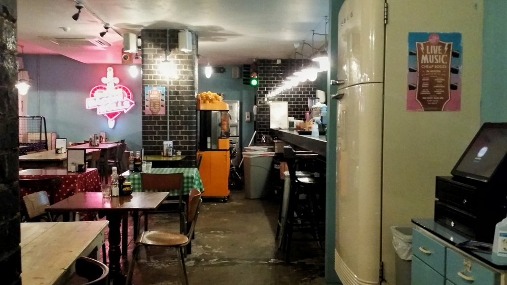 The secret passageway to the underground bar lies inside that fridge!