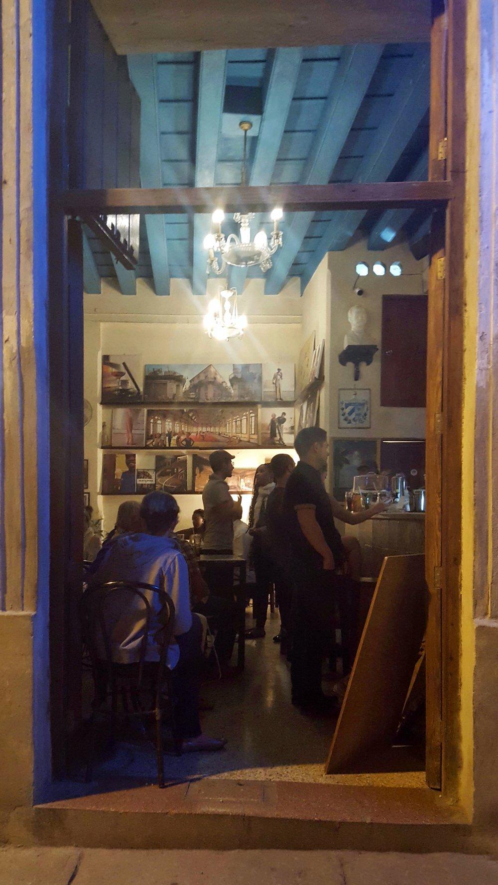 Picking up more cervesas and mojitos-to-go at a bar near La Plaza del Santo Cristo.