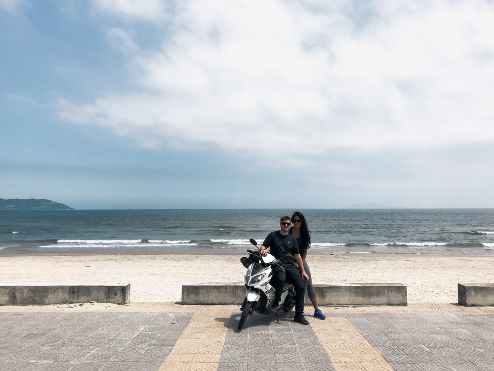 They see me rollin', they hatin', patrolling they tryin' to catch me ridin' dirty. JK we're not that gangster. This is us, taking a break on our motorbike along Danang Beach part way through our ride from Hoi An to Hue.
