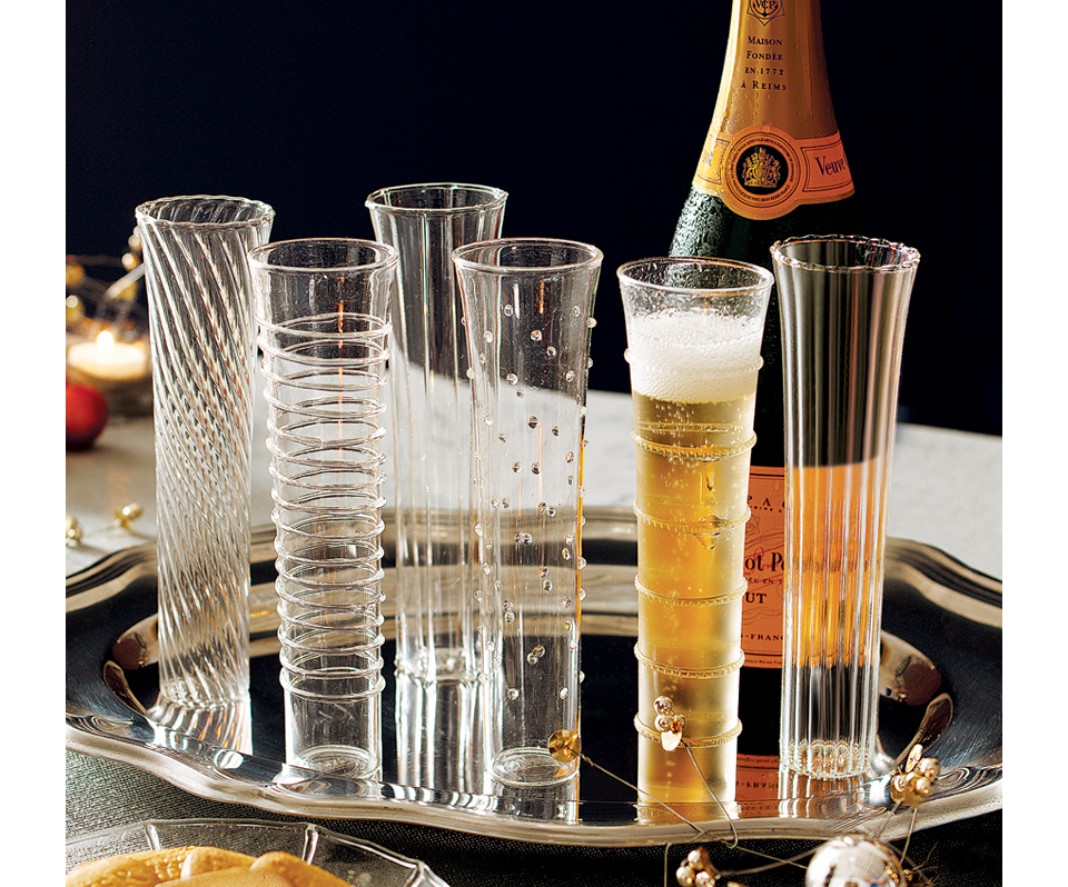 "These champagne flutes are such an elegant twist on the classic! Give your favorite ""hostess with the mostess"" these beautiful Venetian-Style Flutes to liven up here stemware collection!"