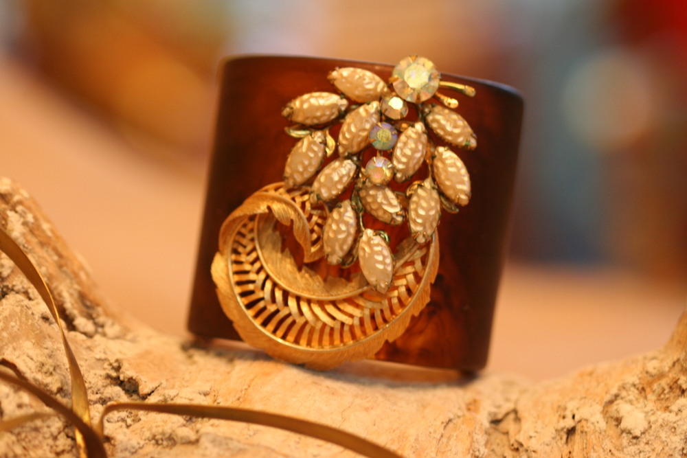 Give the gift of bling with this tortoise cuff, adorned with two vintage brooches!