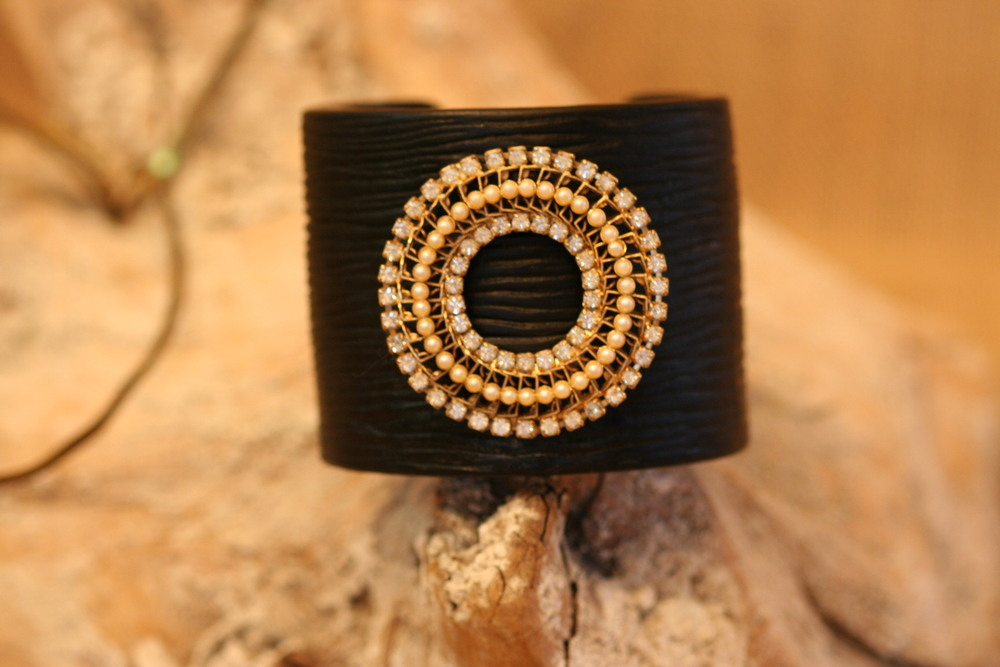 This is another stunning one-of-a-kind cuff from SCD. This black resin cuff is gorgeous, adorned with a vintage rhinestone and pearl brooch.