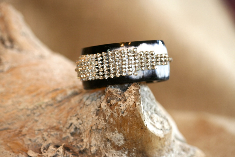 AN SCD Fave! This horn cuff is adorned with a vintage rhinestone earring and is truly one of a kind!