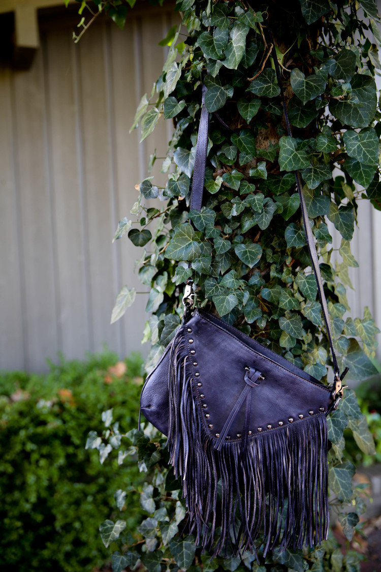 Another easy favorite is this Grey Fringe Leather Purse.