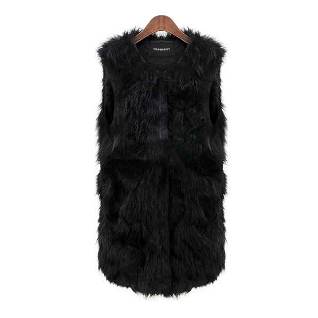 This black faux fur vest is a show stopper! This vest is the perfect accent to any outfit this winter!