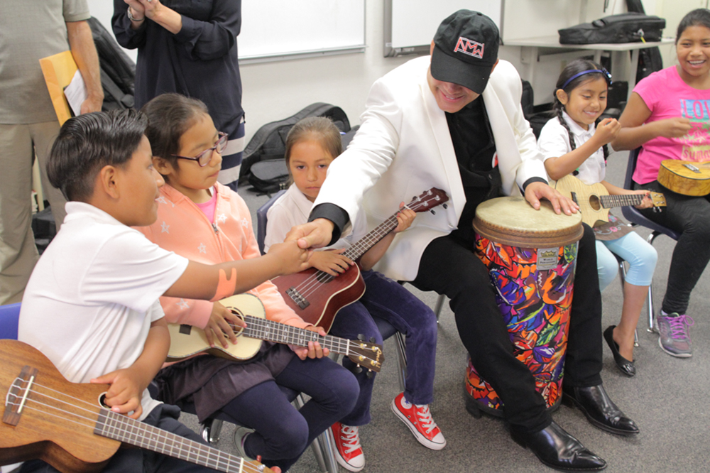 Narada delivers the first of 30 ukuleles to the fifth grade class at San Pedro Elementary School See More Pictures →