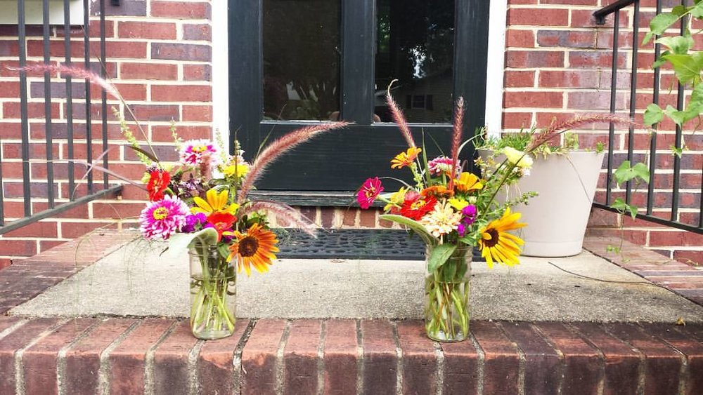 Late summer blooms making our stoop beautiful.