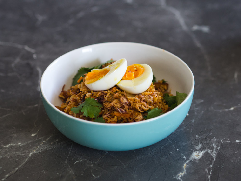 Ingredients Serves 2 -200g GSK White Miso & Dry Red Pepper Kimchi (or other flavour of your choice). -400g Cooked brown rice (cooked previous day) -100g Tempeh or firm tofu (small dice 1-2cm) -¼ Spanish red onion (fine sliced) -Small hand full fresh coriander, mint and flat leaf parsley. -30ml GSK Kimchi hot sauce -2 Tsp Crispy fried shallots -1 Hand full fresh bean shoots -Juice of half a lemon -50ml Soy bean oil -2 free range eggs *We recommend having extra fresh coriander, mint and flat leaf parsley to use as a garnish. Method 1. Preheat your fry pan with oil (we use soy bean oil for this recipe but any oil you prefer is ok). 2. Once oil is hot add the Spanish onions, tempeh/tofu and shallow fry until lightly golden. 3. Add cooked brown rice and continue to gently fry until all the rice granules are coated and loose in the pan, at this stage add a little sprinkle of sea salt and lemon juice to deglaze the pan. 4. Now move the rice mix to one side of the pan and add the kimchi to the other, allow to lightly fry for 30 seconds, then combine the rice back with the kimchi. 5. Ensuring that the heat is now on high and add in the kimchi sauce and fresh herbs, stir over heat until mix is fried together nicely. 6. Turn down the heat and toss through bean sprouts. 7. Serve mix into shallow bowls. 8. In a clean pan lightly fry your eggs leaving soft yolk to crack over rice (we used soft boiled egg in our photos but fried with soft yolk is much better). 9. To finish place soft egg on top and scatter with crispy shallots and more fresh herbs.