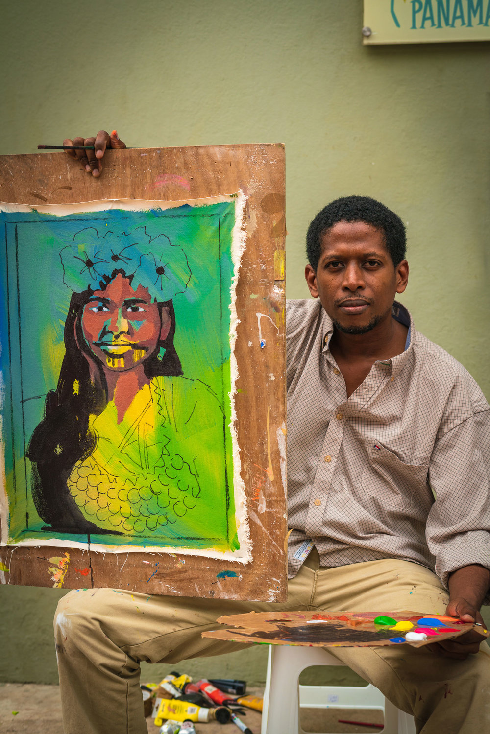 A Cuban artist and his painting, in progress, of a woman from the Embera indigenous community of Panama.