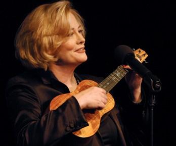 Cybill Shephard playing her island Ukulele