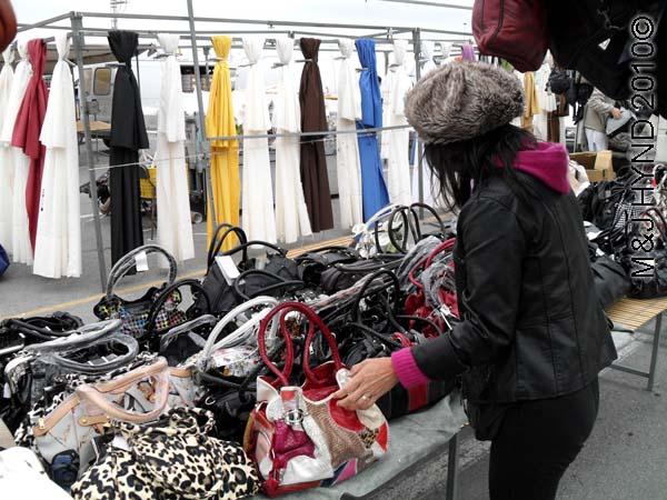 spain santa Pola Saturday market shopping for shawls, handbags