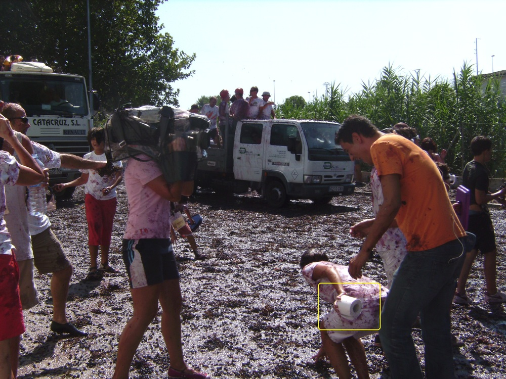 camera operator and director/assistant: spain La Pobla del Duc, Fiesta La Raima, Battle of the Grapes, caught on TV, splattered, ground mushy with squashed grapes, offers toilet paper