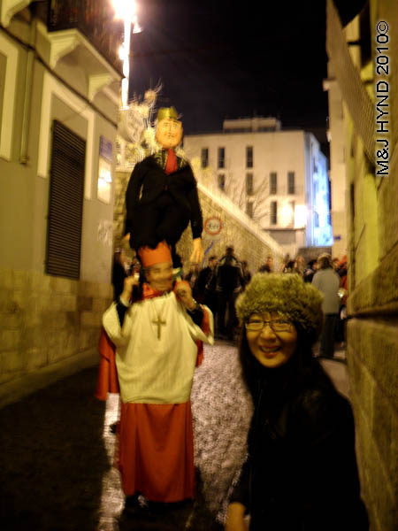 carrying the puppet / medieval #2.: spain Alicante Carnival Fiesta, Costa Blanca, court jester, strolling troubadours, carry the puppet, narrow cobbled alleyway, medieval music spectators