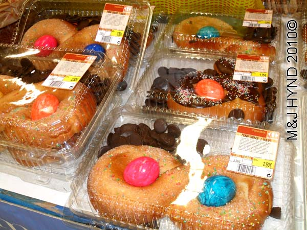 easter treats: spain elche, Semana Santa Holy Week, pastry doughnuts, multi-coloured eggs, chocolate buttons