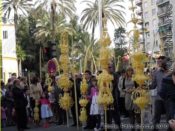 spain elche, Semana Santa Holy Week, Palm Sunday, Domingo de Ramos, close-up intricate white-palm leaves, spectators