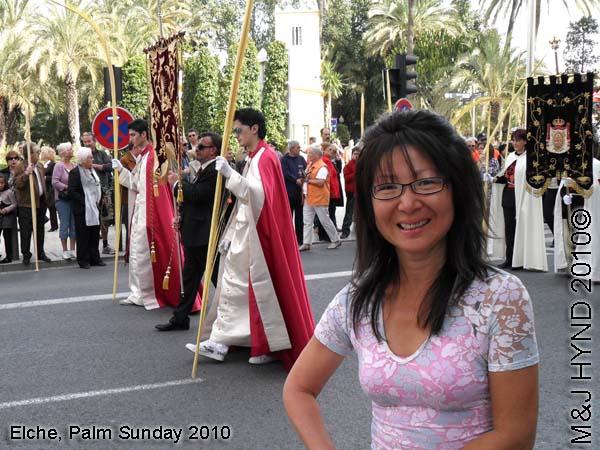 spain elche, Semana Santa Holy Week, Domingo de Ramos, Palm Sunday Procession Fiesta of International Tourist Interest, Brotherhood flag-bearers long capes, white-palms, somber march, Palm park