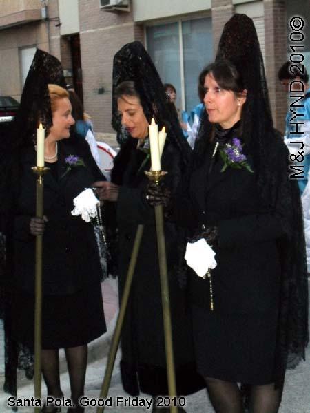 spain Santa Pola, Semana Santa Holy Week, Good Friday procession, black lace-mantilla dressed ladies carry candle on poles