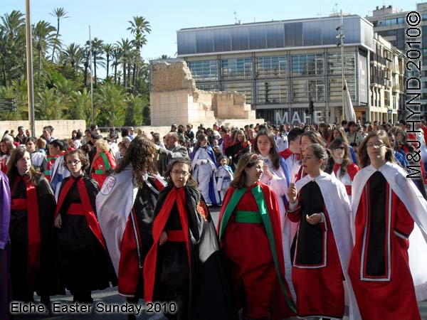 spain elche, Holy Week, Hallelujah Procession of the Brotherhood Easter Sunday, many-coloured long robes capes, Palacio de Altamira, M.A.H.E., crowded street parade,