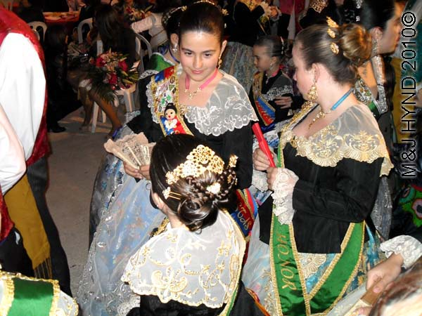 3 girlies: spain perleta maitino St Vicente de Ferrer Fiesta, ladies-in-waiting, traditional long gowns, winner's sashes, ladies traditional coiffed high-combed hairdo, lace mantilla, peineta