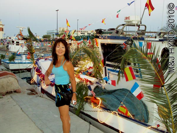 jacq+fishing boats: spain santa Pola Fiesta La Virgen del Carmen, patroness of fishermen, fishing boats, flags buntings