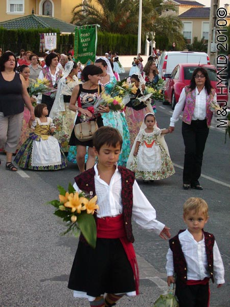 parade of kids: spain valverde fiesta  La Virgen de Santa Ana, children adults partipants traditional long ballgown lace mantilla, Damas of Fiesta, floral offering procession