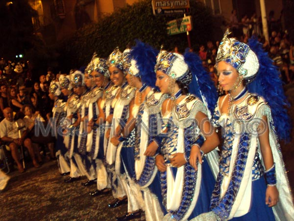 parade blu+white: spain Santa Pola Annual Fiesta, procession Moorish harem ladies, confetti