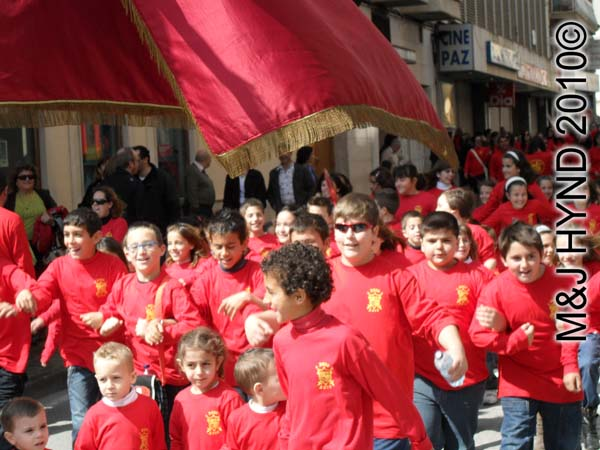 band of red kids: spain Santa Pola Annual Fiesta, band of red kids parade