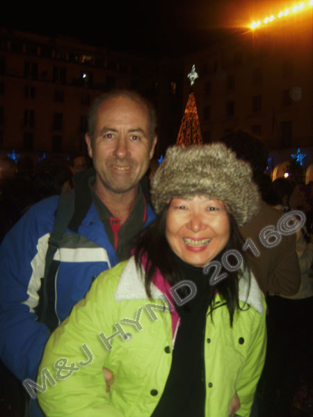 spain downtown Alicante, fiesta nochevieja New Years Eve, revellers warm gear