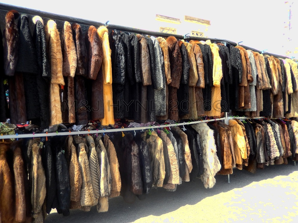 spain santa Pola Saturday market shopping for long short fur jackets