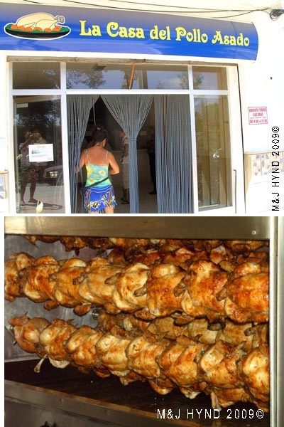 Spain La Marina La Casa del pollo asado shop, rotisserie roasted chicken in the cooker