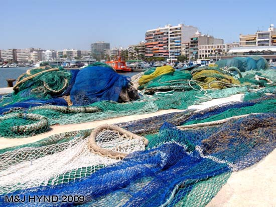 pain Santa Pola Fishermens' tools of the trade, multi coloured nets in port area, town
