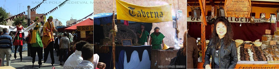 Spain Santa Pola, medieval entertainers on stilts,; Moroccan tagines in atmospheric Berber tents in medieval market at Castillo Fortaleza de Santa Pola, array of chocolate turron, honey, almond nougat, fig cakes, dates, cakes, for sale