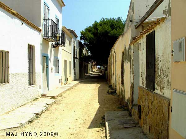 Spain isla Tabarca  marine nature reserve , dry dusty cowboy and western movie, unpaved narrow lanes