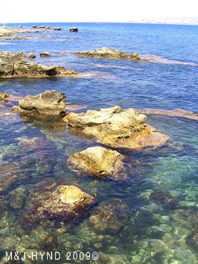 Spain isla Tabarca  marine nature reserve  Crystal clear waters great boulders, see Santa Pola across the Mediterranean sea