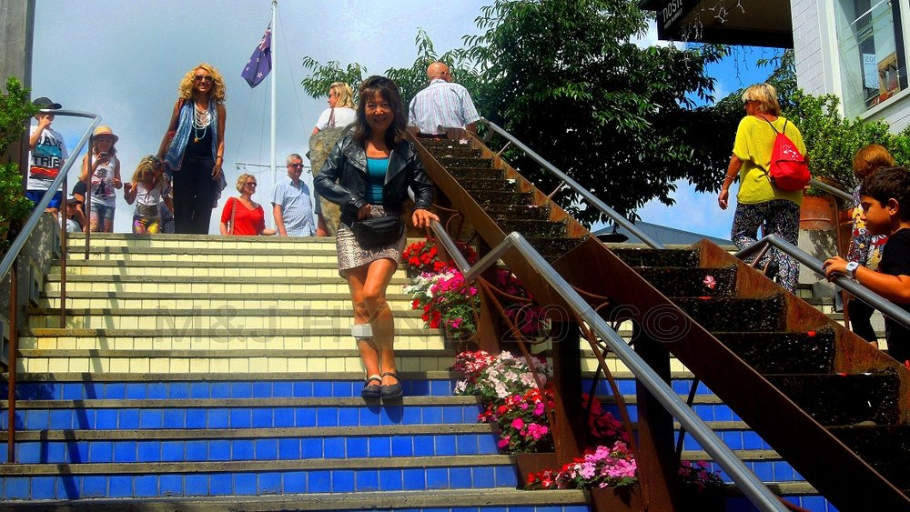 ...down colourful steps...