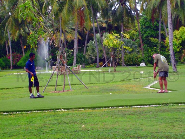 round of 9 holes on tropical golf links, Sun Island, Maldives