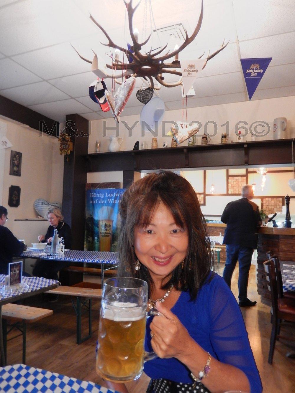 Carinthia restaurant Oktoberfest raising a beer, Auckland, NZ