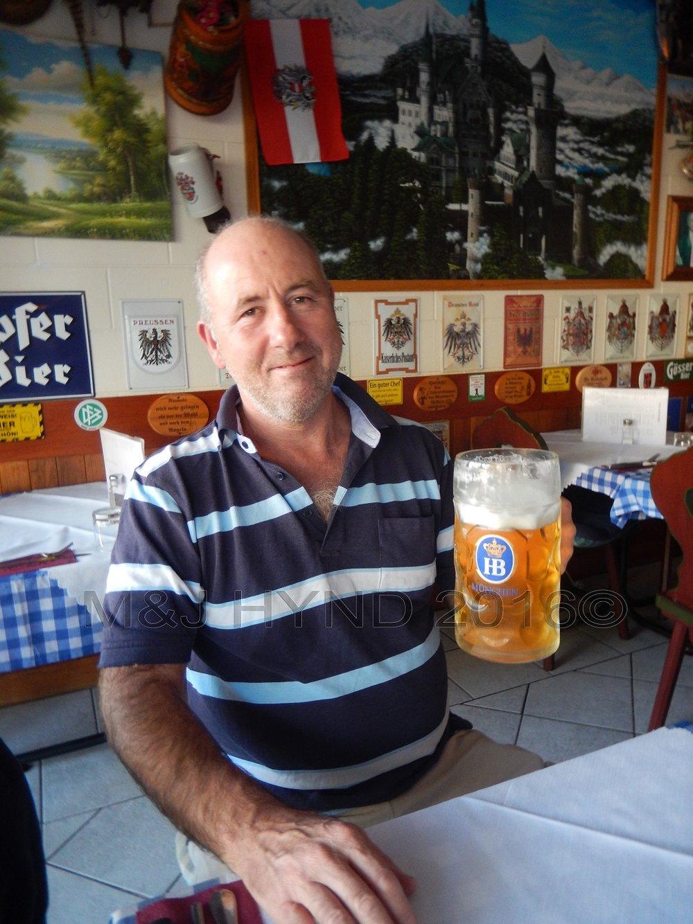 Der Metz restaurant Oktoberfest raising a beer, Auckland, NZ