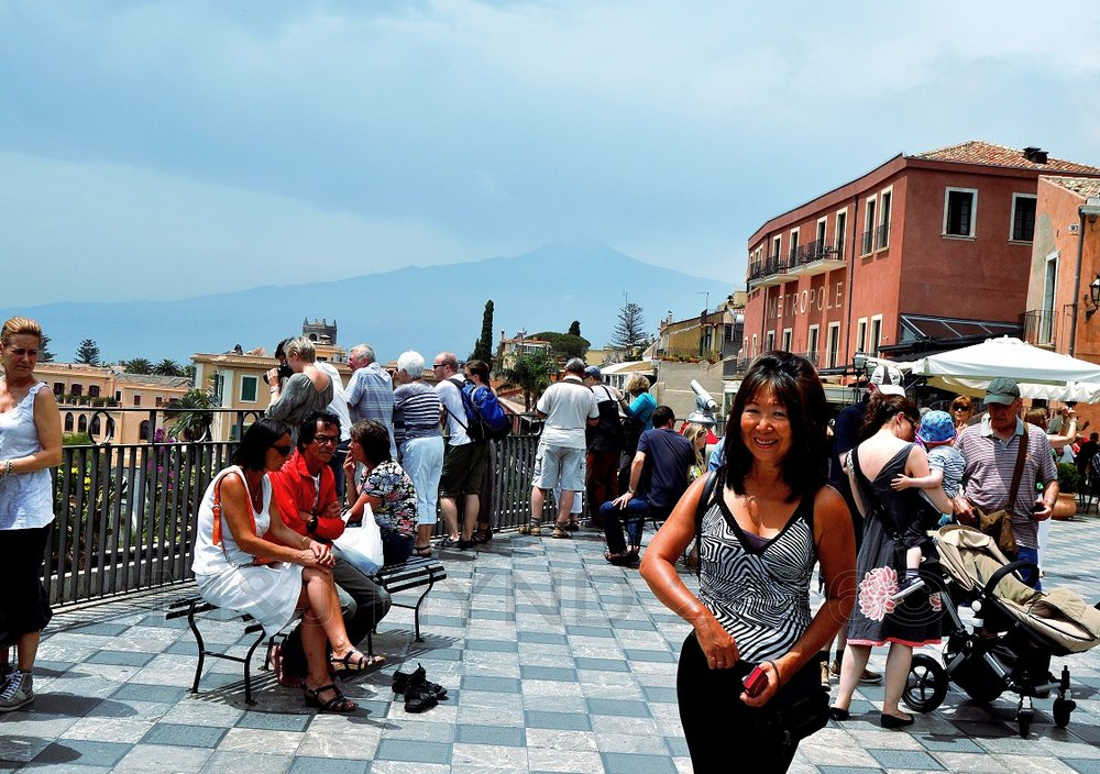 main piazza with Mt. Etna in the distance, Taormina, Sicily, Italy