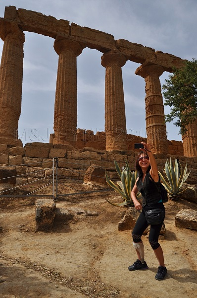 selfie on sloping ground, ruins Valley of the Temples, Agrigento, Sicily