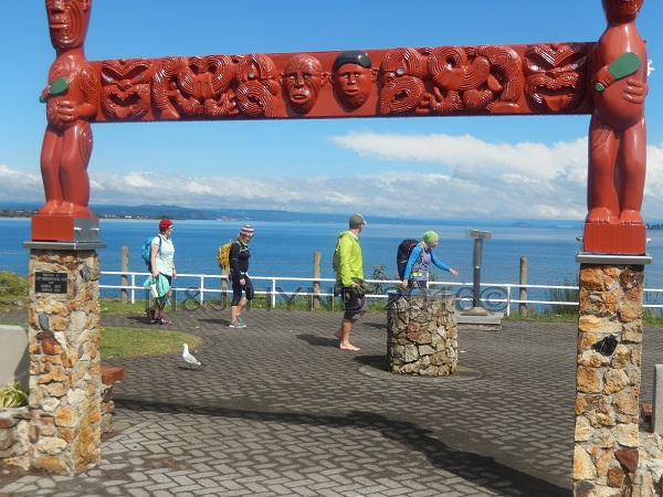walkers in the sun at Lake Taupo edge, Taupo, NZ