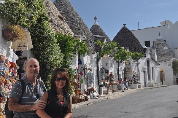street view of Trulli businesses and homes, Alberobello, Puglia, Italy