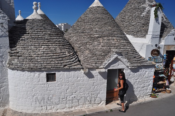 street view of Trulli homes and businesses, Alberobello, Puglia, Italy